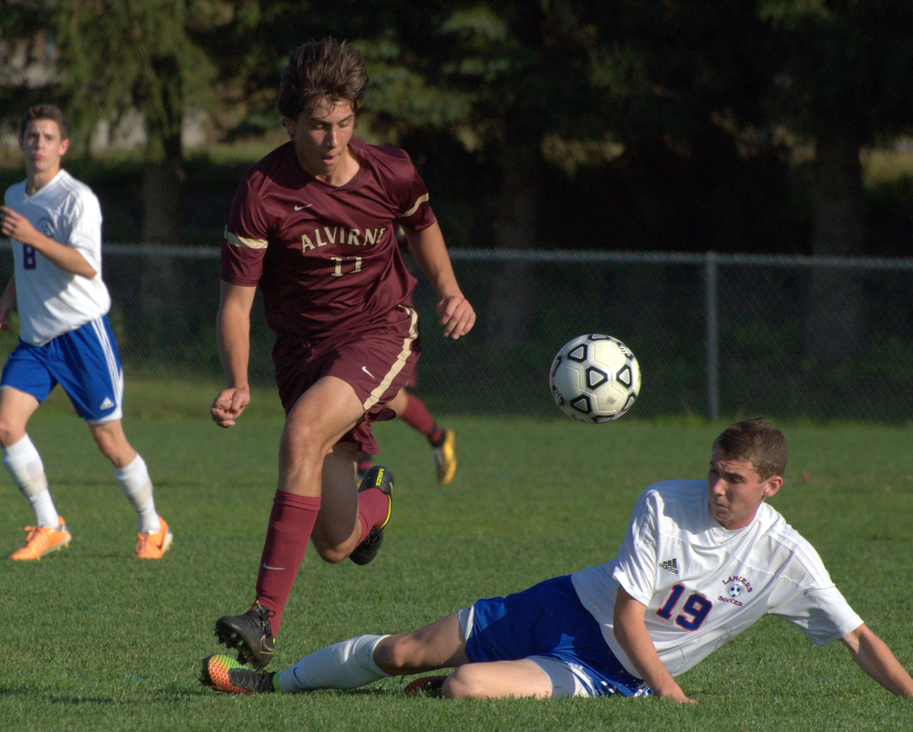 Londonderry's Max Hastings knocks the ball away from Alvirne's Raul Stedile during Monday's game.