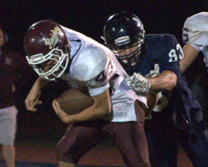 Milford football pounds its way past Lebanon
