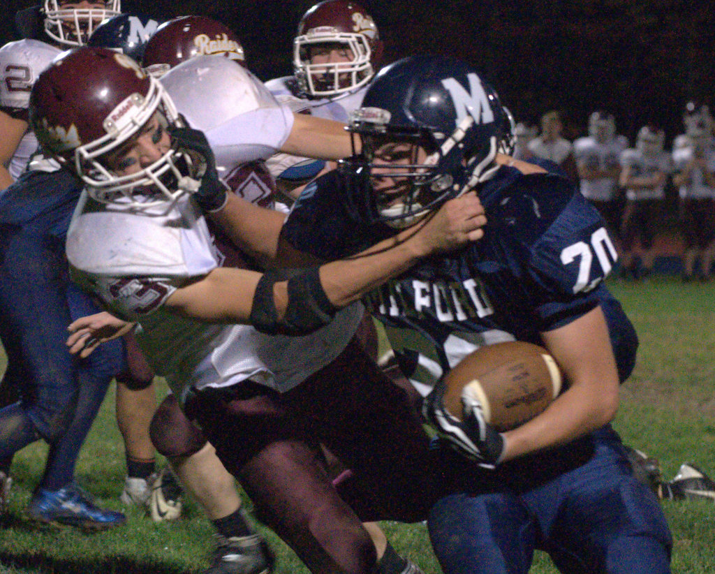 Milford's Mark Madigan tries to fight off a tackle by Lebanon's Cameron Broughton during Friday's game.