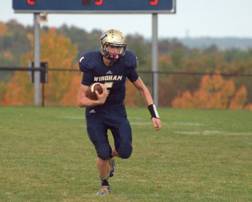 Windham's Kurtis Jolicoeur runs with the ball during Saturday's game against Pelham.