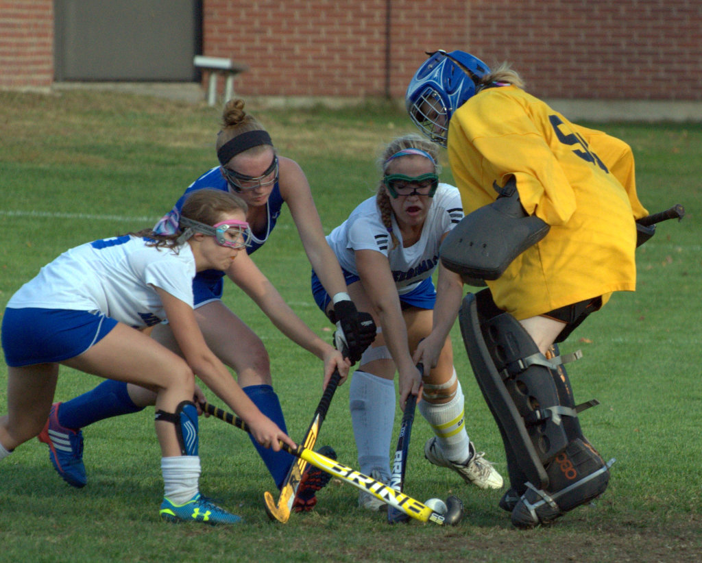 Winnacunnet and Merrimack players fight for the ball in front of Merrimack goalie Mac Hennas during Wednesday's game.