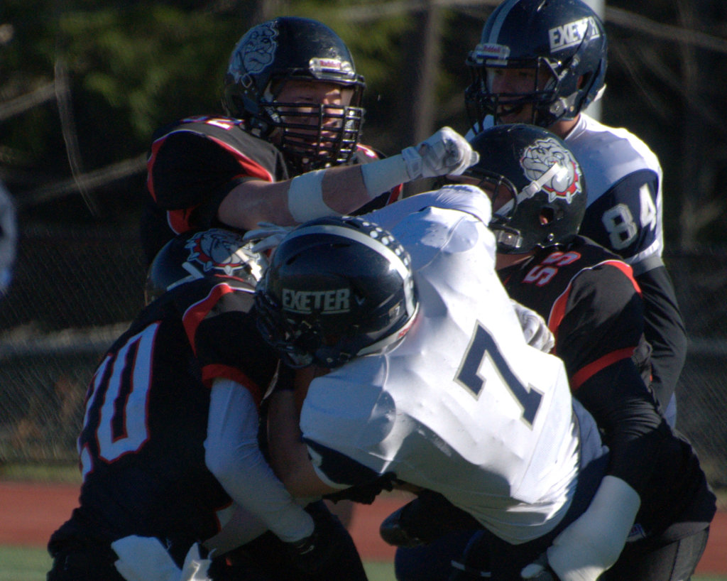 The Bedford defense wraps up Exeter's Shane Quimby during Saturday's Division I semifinal.