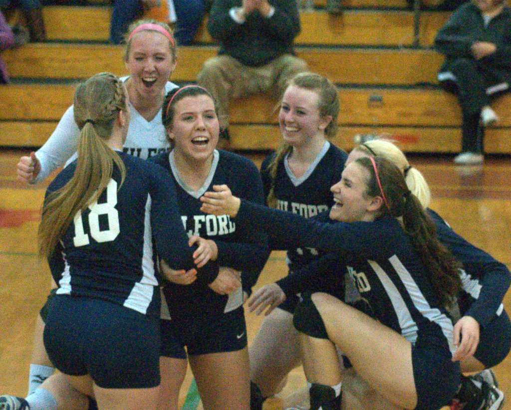The Milford girls volleyball team celebrates after its win over Gilford in the Division II semifinals.