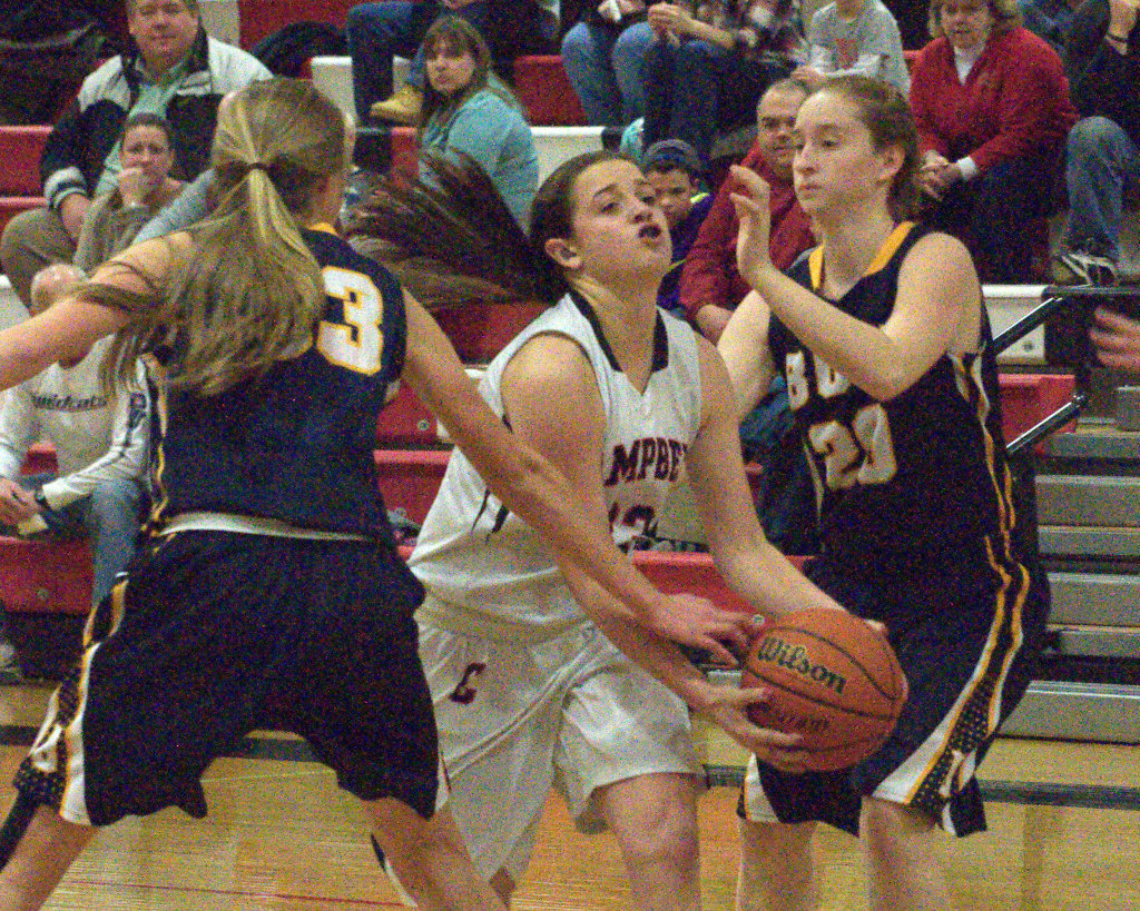 Campbell's Hannah Neild tries to drive past Bow's Abigail Horner, left, and Samantha Lulka during Friday's game.