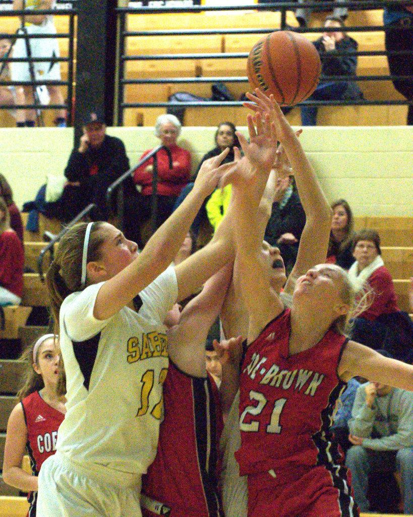 Souhegan's Hannah Chick and Coe-Brown's Haley Ruth battle for a rebound during Tuesday's game. For more photos, go to the Photo Album.