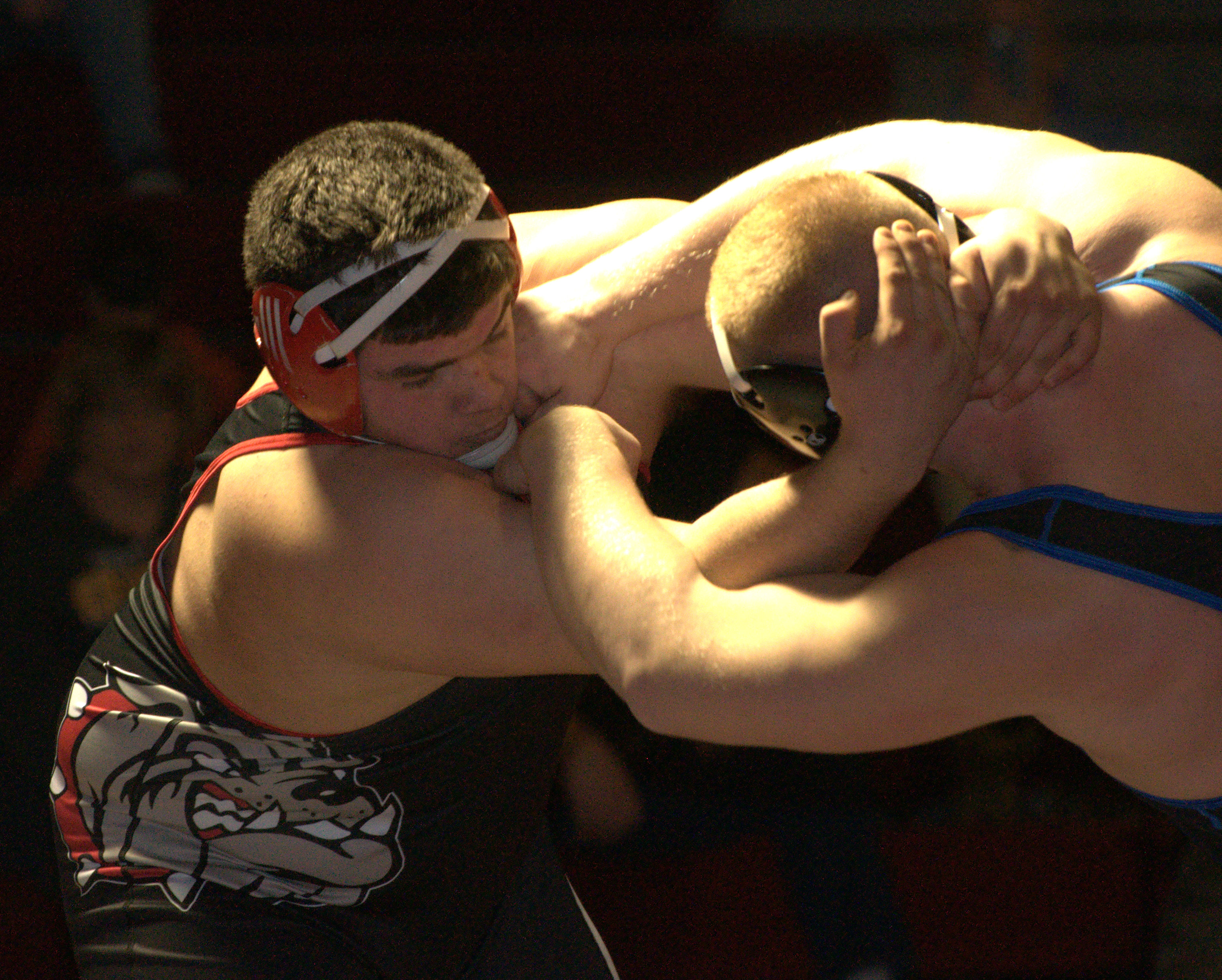 Bedford's Bobby Heald wrestles Salem's Michael Poulin during Wednesday's dual meet.
