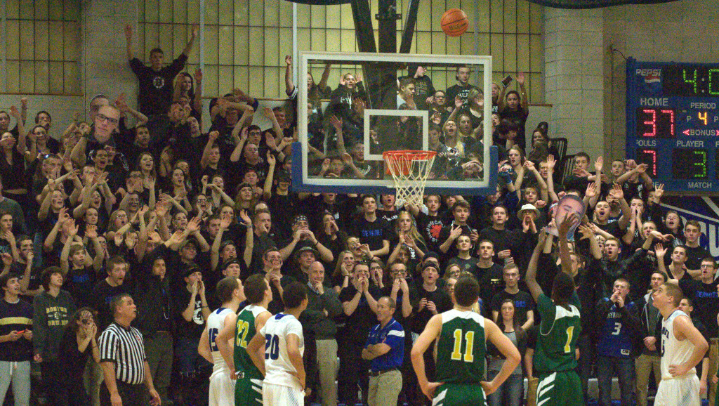 The Merrimack student section tries to distract Bishop Guertin during a free throw Friday night.