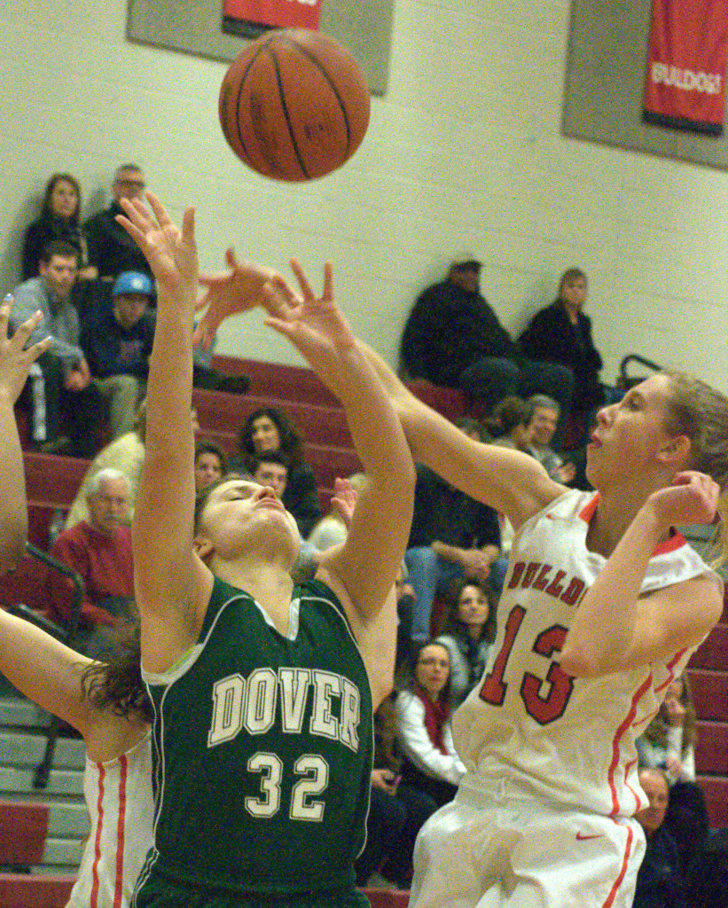 Bedford's Courtney O'Connell blocks a shot by Dover's Mercedes McDermott during Wednesday's game. For more photos, go to the Photo Album.