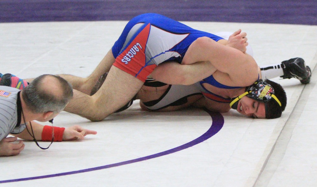 Londonderry's Jean-Luc Lemieux tries to pin Timberlane's Danny Scalzo in the 138-pound title match during Saturday's NHIAA Division I Championships at Nashua South. Lemieux went on to win the title with a 7-0 decision. (Courtesy photo by George Scione)