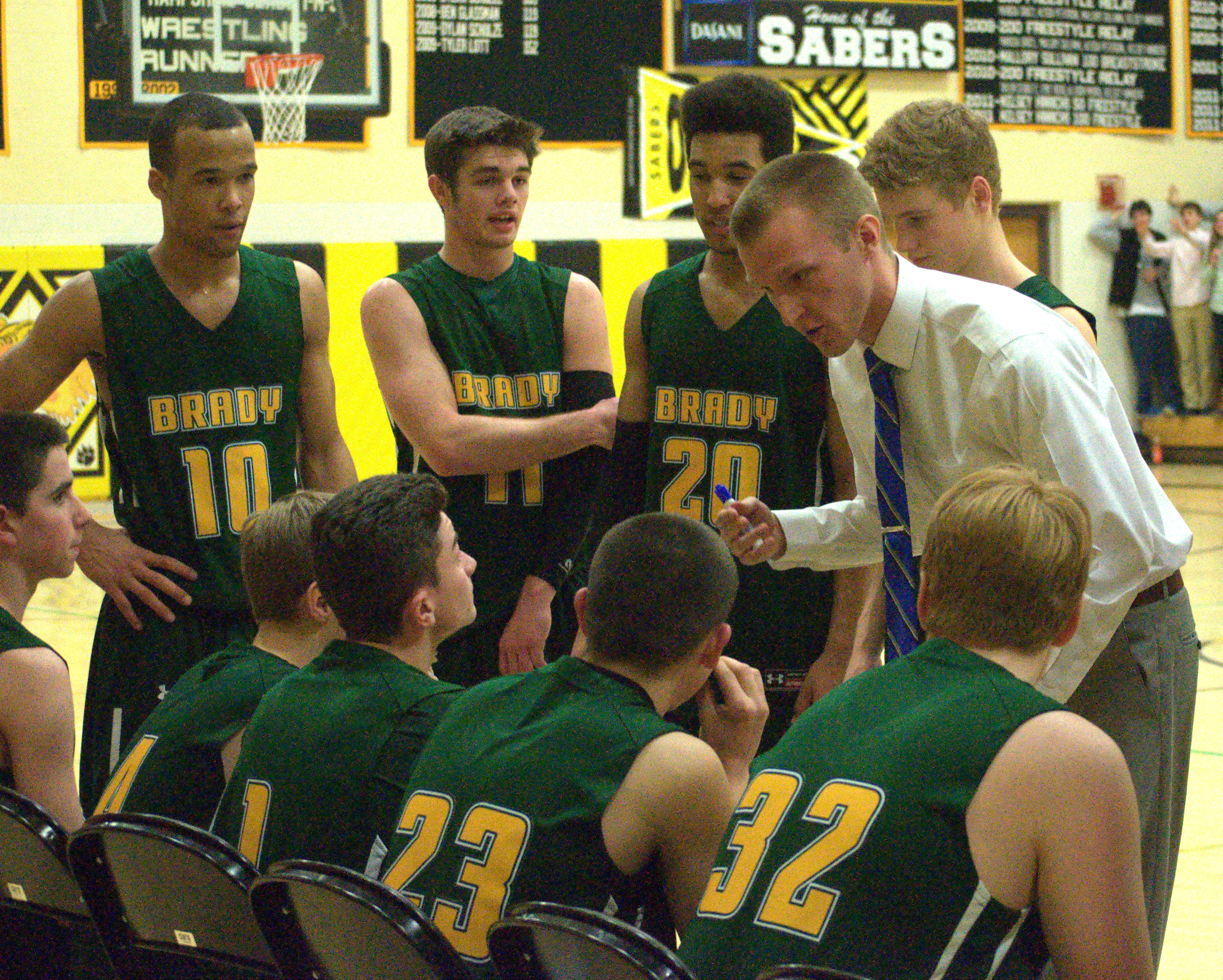 Bishop Brady coach Cole Etten talks to his team during a timeout.