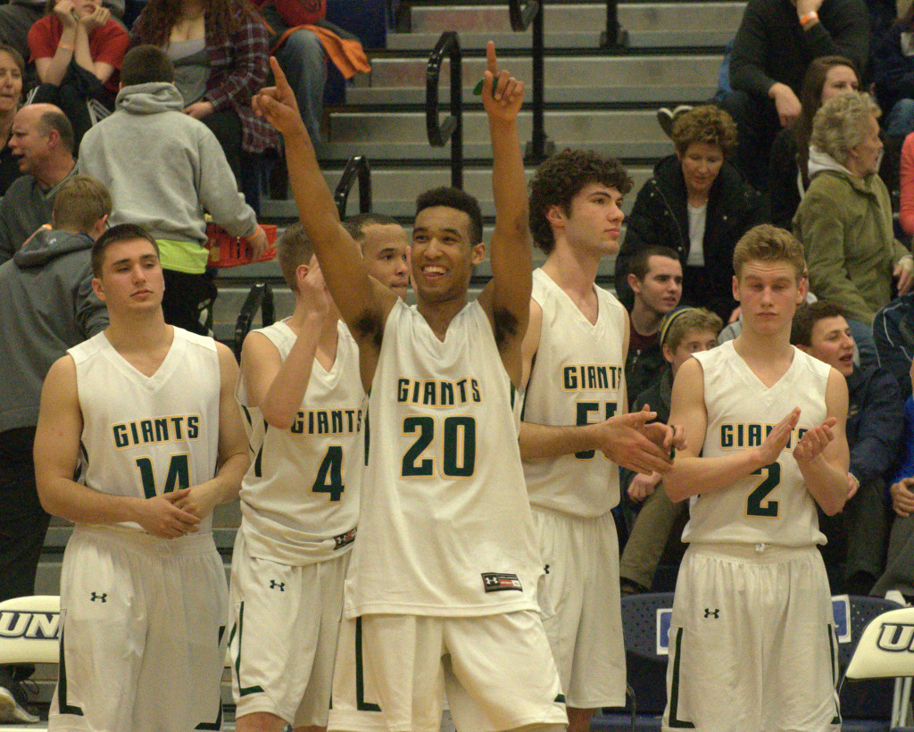 Bishop Brady's Joe Bell points to the crowd after the Giants defeated Goffstown in the Division II semifinal on Wednesday.