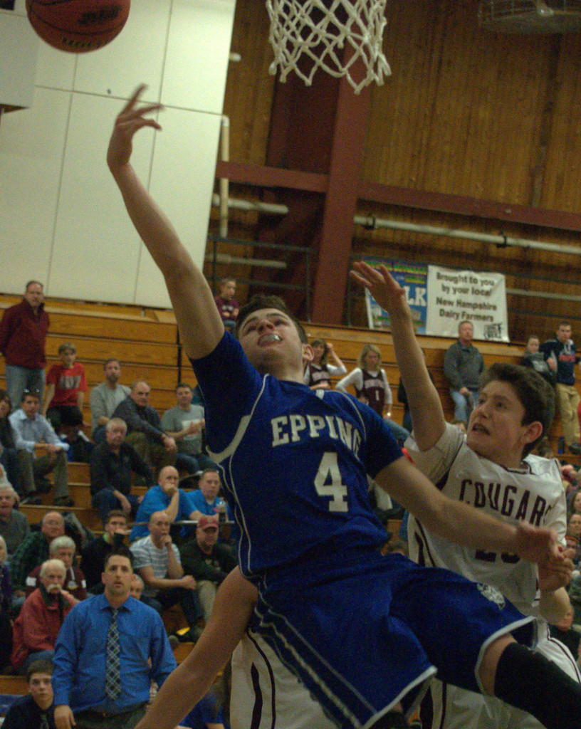 Epping's Dylan Derosier puts up a shot as Derryfield's Burton Owen defends during Monday's semifinal. For more photos, go to the Photo Album.