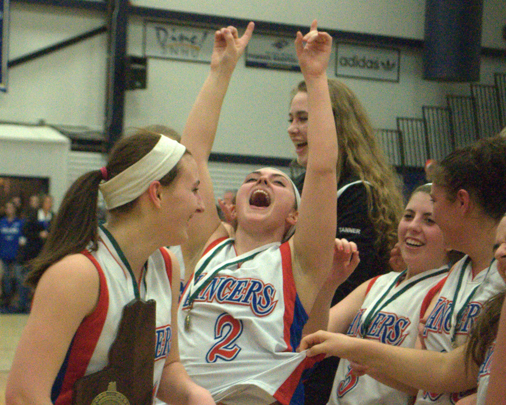 Londonderry's Katherine Wells, center, celebrates with her teammates Friday after the Lancers defeated Winnacunnet to win the Division I championship.