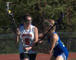 Bedford girls lacrosse holds off Merrimack
