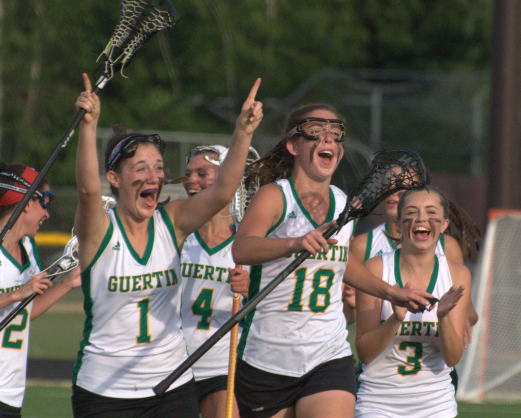 Bishop Guertin celebrates after beating Exeter in the Division I final.