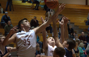 Portsmouth's Joey Glynn battles with other players for a rebound.