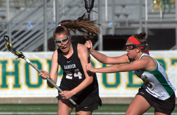 Bishop Guertin's Bryn Carroll tries to slow down Hanover's Molly Seibel.