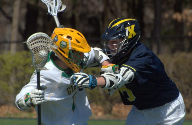 Bishop Guertin's Michael O'Reilly tries to avoid a hit by Xaverian's Jack Whalen.