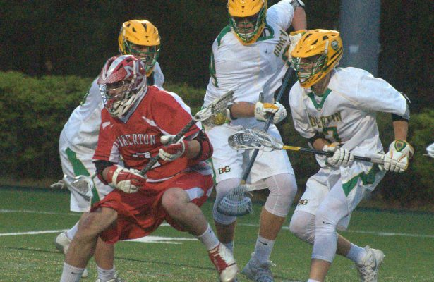 Pinkerton's James Tulley gets by three Bishop Guertin players on his way to the cage.